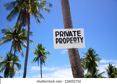 Private Property sign on a palm tree on Malapascua island, Philippines