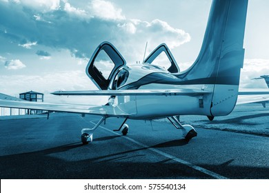 Private single turboprop aircraft parked on runway in sunny day. Travel concept. Sport concept. Ready for fly.