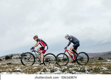 Privetnoye, Russia -  September 21, 2016: two cyclist mountainbiker sports bike ride on a mountain trail during Crimean race mountainbike