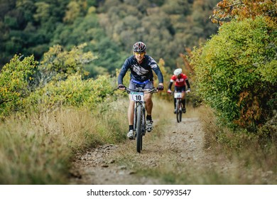 Privetnoye, Russia -  September 22, 2016: middle-aged man racer cyclist riding uphill during Crimean race mountainbike