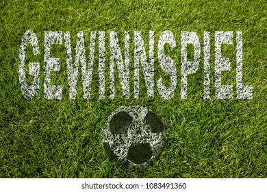 Prize game (in german) written on soccer meadow