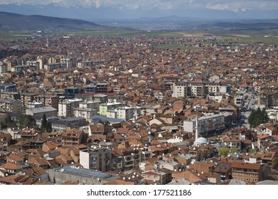 PRIZREN, KOSOVO - APR 10: Cityscape of second biggest city of Kosovo at sunset with red roofed houses and mosques and river in the background a mountain range in Prizren, Kosovo on April 10 2013.