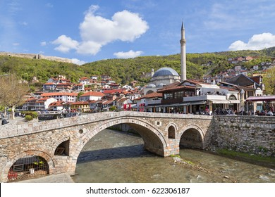 PRIZREN, KOSOVO - APRIL 7, 2017: Old stone bridge and mosque in Prizren, Kosovo.