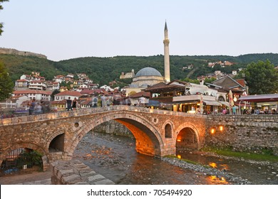 PRIZREN, KOSOVO - August 15,, 2017: Evening view of old stone bridge and mosque in Prizren, Kosovo - long exposure