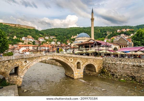 PRIZREN, KOSOVO - JULY 27,2014 - Evening view at the old stone bridge in Prizren. Prizren is a historic city located in Kosovo.