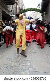 """PRIZZI, ITALY - April 20, 2014: Holy Week in Sicily. Festival """"Dance of the Devils"""" in Easter.  It is represented the death and two devils go in search of souls. eternal struggle of good and evil"""
