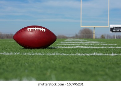 Pro American Football on the Field with Goal Posts Beyond