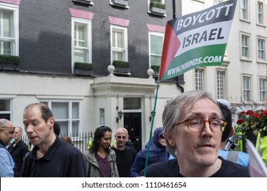 A pro Palestine protester waves a free Palestine flag Al Quds Day rally, London, 10/06/18.