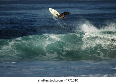 pro surfer riding wave (editorial use only)