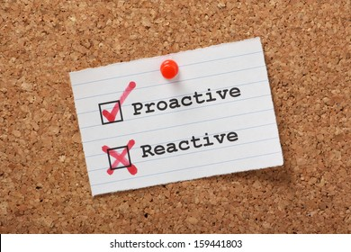 Proactive and Reactive tick boxes on a paper note pinned to a cork notice board.