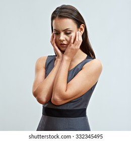 Problem in business. Concept emotional portrait of sadness business woman. Studio isolated portrait. Headache.