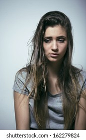 problem depressioned teenage with messed hair and sad face