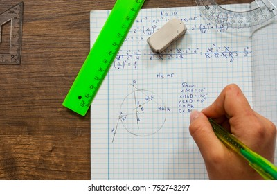problem of mathematics. school, education, people and learning concept - close up of student or woman hands with pen writing in notebook