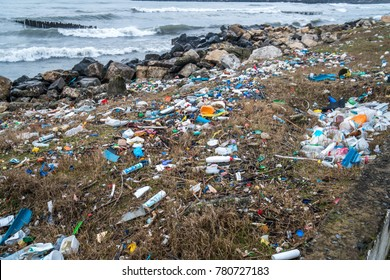 The problem of pollution and ecology of the sea shore and the ocean. Garbage on the coastline and in the world.