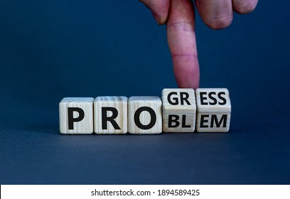 Problem or progress symbol. Businessman hand turns wooden cubes and changes the word 'problem' to 'progress'. Beautiful grey background. Business and problem or progress concept. Copy space.