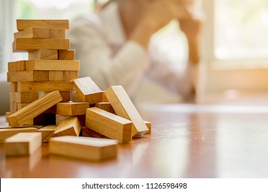 Problem Solving Business can't stop effect of dominoes continuous toppled with business team feeling sad and stress in office background. Failure Business Concept.