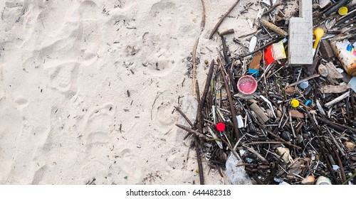 The problem of trash on the beach caused by man-made pollution and environmental in concept