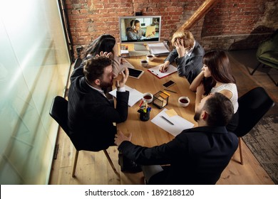 Problem. Young people talking, working in videoconference with colleagues, co-workers at office or living room. Online business, education during insulation, quarantine. Work, finance, tech concept.