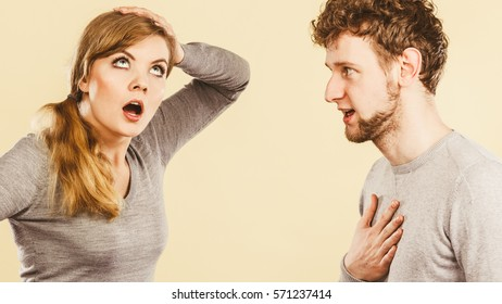 Problems in relationship. Young blonde couple arguing and yelling on each other. Emotional way to express bad feelings.