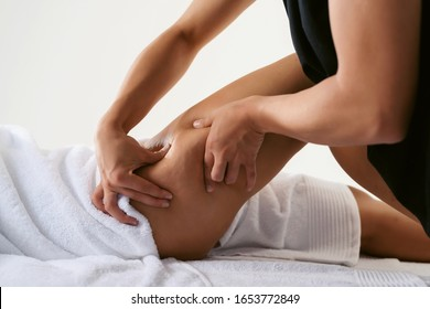 Problems of women body. Close up of anti cellulite massage for young woman in wellness center. Perfect skin fat burning beauty concept