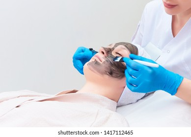 Procedure carbon facial peeling in the clinic of laser cosmetology.