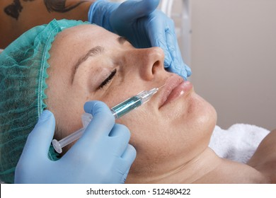 The procedure for facial contouring. Injections of beauty. Smoothing wrinkles using injections. Changing the volume and shape of lips