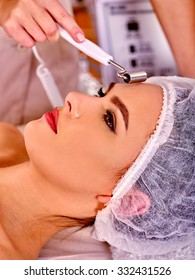 Procedure of hydradermie. Young woman receiving skincare in beauty salon.
