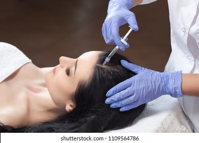 Procedure of mesotherapy. The doctor cosmetologist makes the procedure of mesotherapy in woman's head. Strengthen hair and their growth.