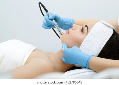 Procedure of Microdermabrasion. Mechanical Exfoliation, diamond polishing. Mode, profile. Cosmetological clinic. Healthcare, clinic, cosmetology