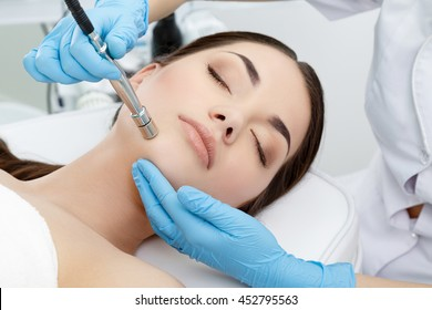 Procedure of Microdermabrasion. Mechanical Exfoliation, diamond polishing. Model, close-up. Cosmetological clinic. Medical equipment. Healthcare, clinic, cosmetology