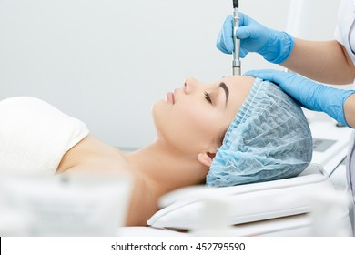 Procedure of Microdermabrasion. Mechanical Exfoliation, diamond polishing. Model, close-up, profile. Cosmetological clinic. Patient. Healthcare, clinic, cosmetology
