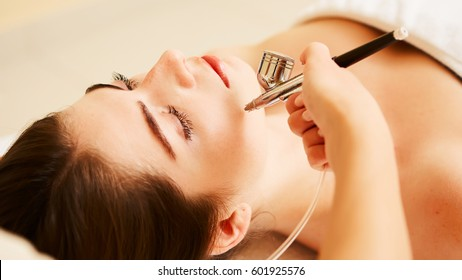 Procedure of Microdermabrasion. Mechanical Exfoliation, diamond polishing. Model, close-up. Cosmetological clinic. Medical equipment. Healthcare, clinic, cosmetology.