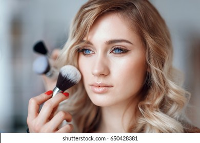 Process of applying makeup on the girl's face, close-up