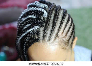 process of attaching Senegal braids to dreadlocks, African hairstyles, spirals, pigtails