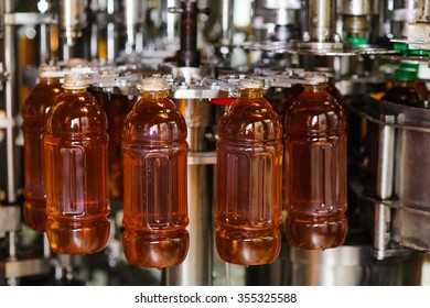 process of bottling on production line