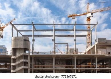 The process of building multi-storey parking for cars. Concrete interior of unfinished parking area