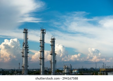 Process Columns of Natural Gas Plant with blue sky and cloud background