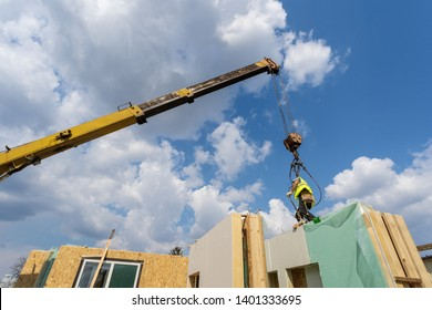 Process of construction new and modern modular house from composite panels. Collar worker standing on sip panel and working on building development industry of energy efficient property