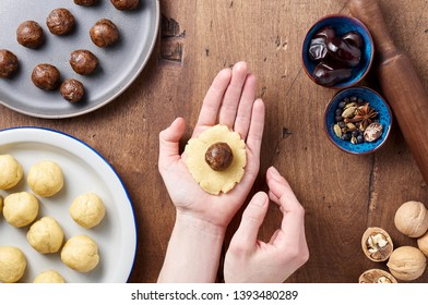 The process of cooking arabic homemade cookies filled with dates. Eid or Ramadan festival concept. Closeup view of top