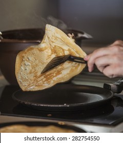 The process of cooking pancakes on a hot skillet