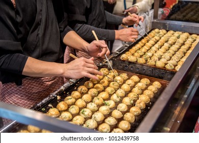 Process to Cooking Takoyaki on hot pan Famous food Osaka Japan street food