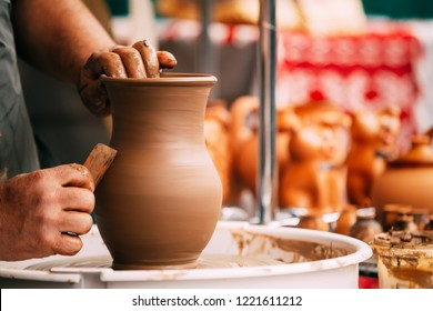 Process Of Creating A Clay Pot. Using Hands. Pottery Craft Wheel And Ceramic Clay Pot. Traditional New Handmade Of Clay Pot. Art And Successful Work, Experience, Creativity And Inspiration Concept