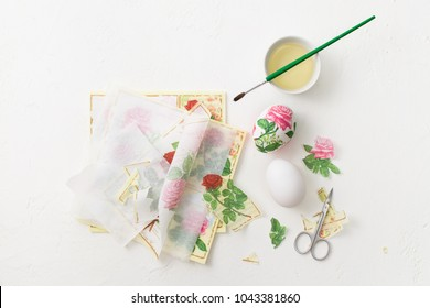 The process of creating decoupage on eggs in floral style. A delicate pink palette. Copy space text.