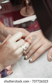 The process of creating a manicure on beautiful hands and nails