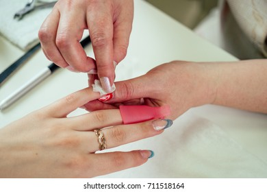 the process of creating a manicure in a women's beauty salon close-up