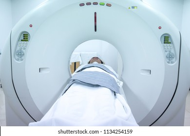 Process of CT scanning of an old patient. Man Receiving a Medical Scan for a Trauma