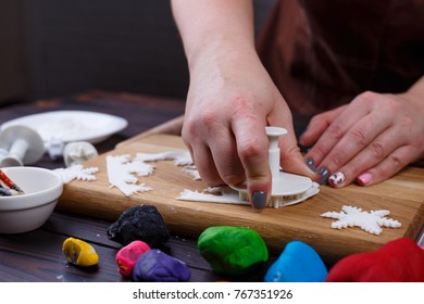 Process Of Cutting Decorations In Form Of Snowflakes Of Confectionery Mastic,  Close Up. Family