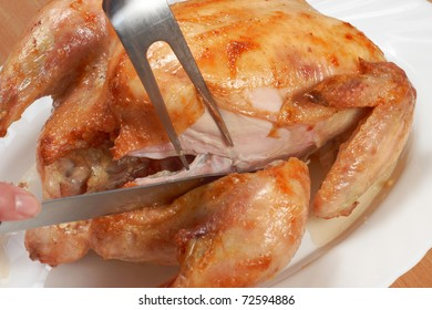 a process of cutting of grilled chicken