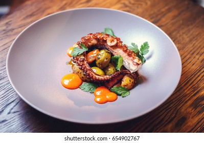 The process of eating the delicious grilled octopus. jukkumi bokkeum is korea traditional webfoot octopus with vegetable stir fry.