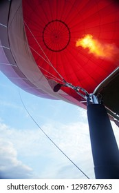 process of filling air balloon with hot air and fire, view from bottom